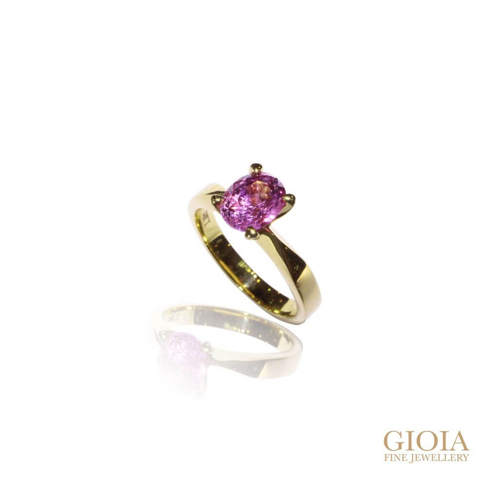 customised purple sapphire gemstone with yellow gold