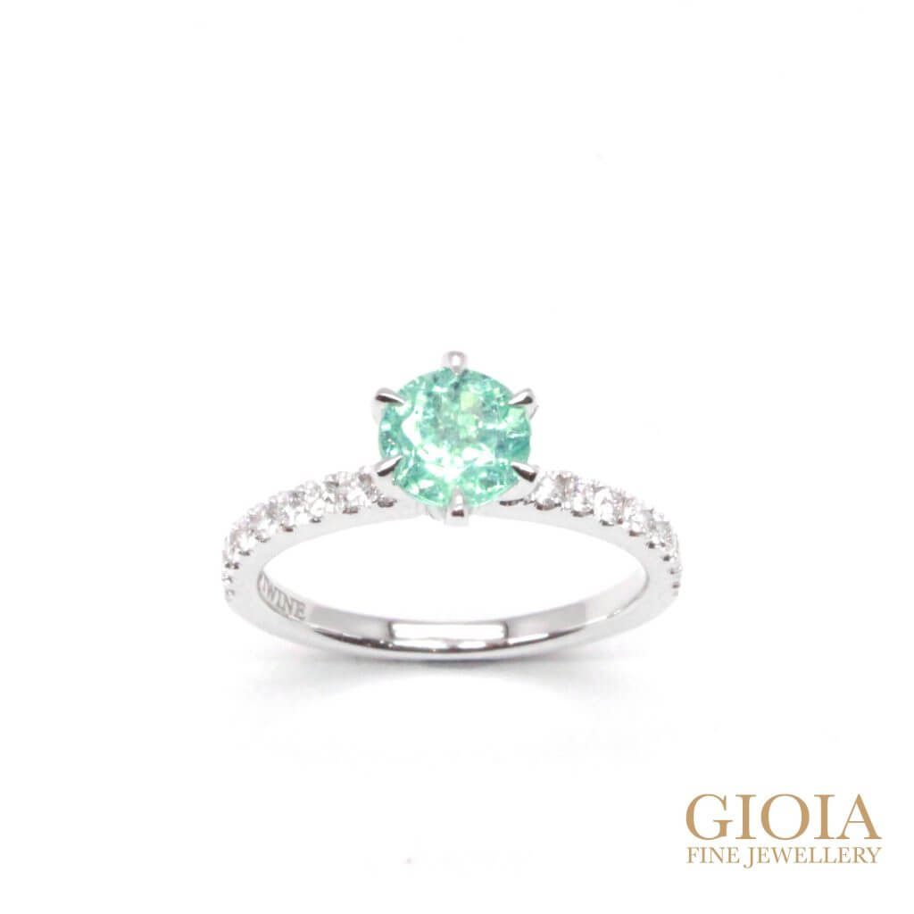 Unique Neon Paraiba Tourmaline Gemstone, custom set in six prongs ring with round brilliant diamonds. The perfect proposal ring for wedding engagement | Local Singapore Custom Jeweller