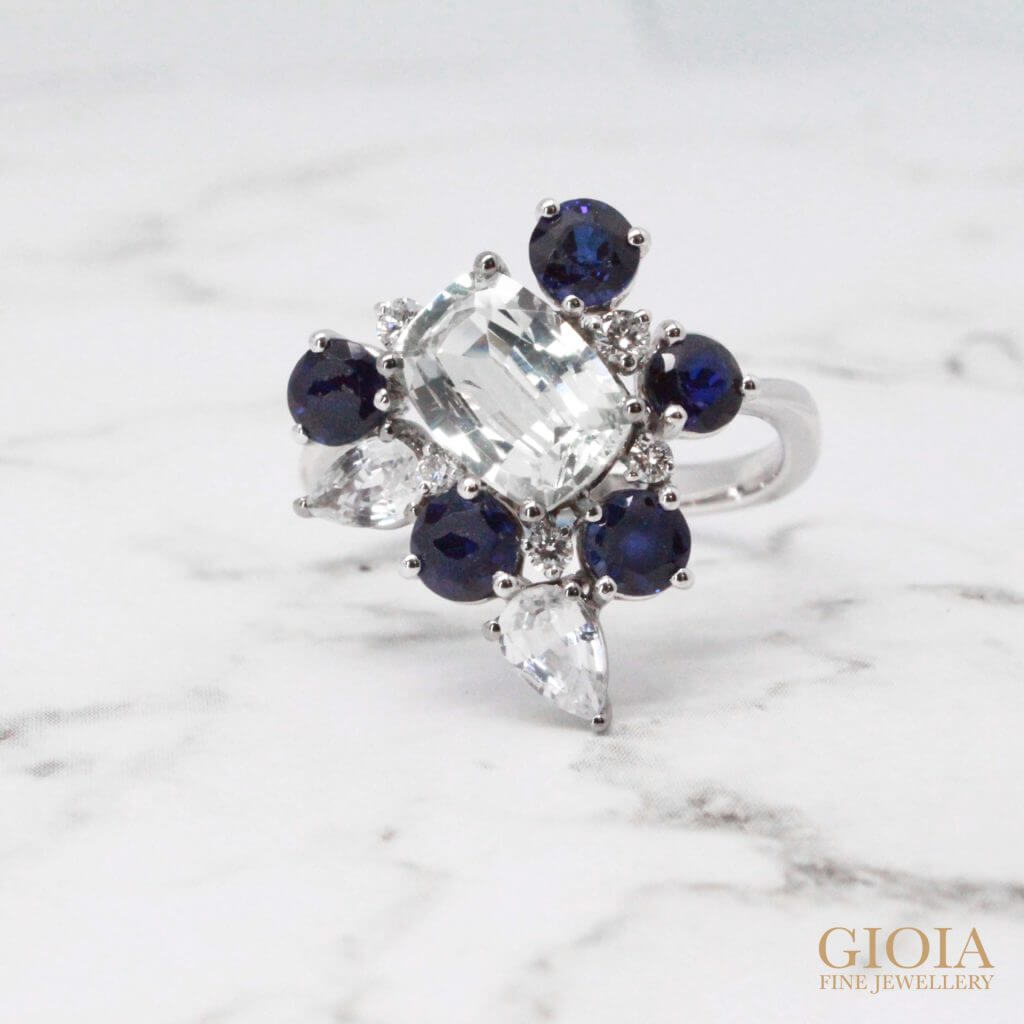 White and blue colour sapphire gemstone on existing jewellery. redesign and style to a unique jewellery design. Bespoke jewellery with different creation