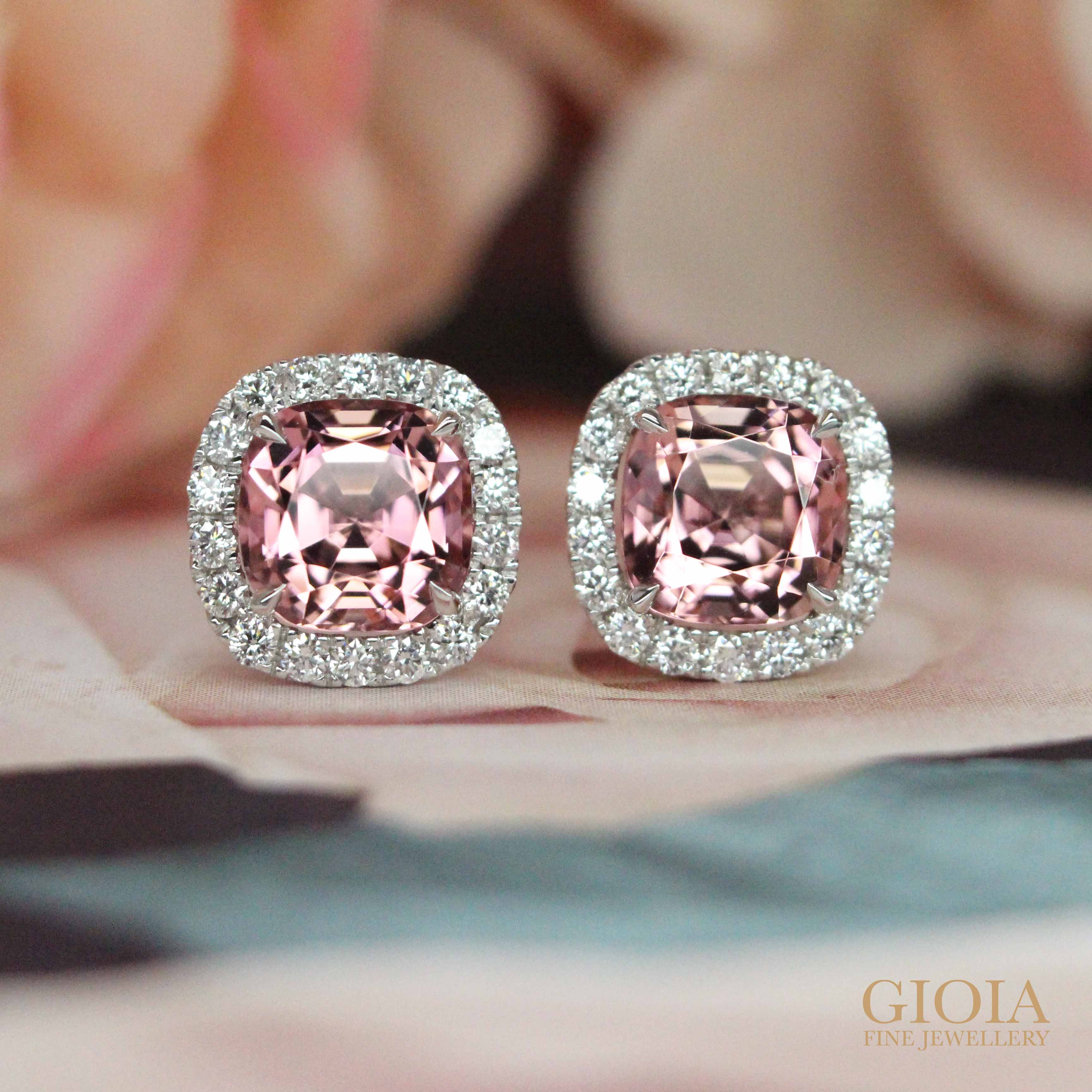 Pink Tourmaline gemstone in cushion modified brilliant cut to showcase the clean and define facets - Customised the tourmaline earring with halo Diamonds surround the gemstone.