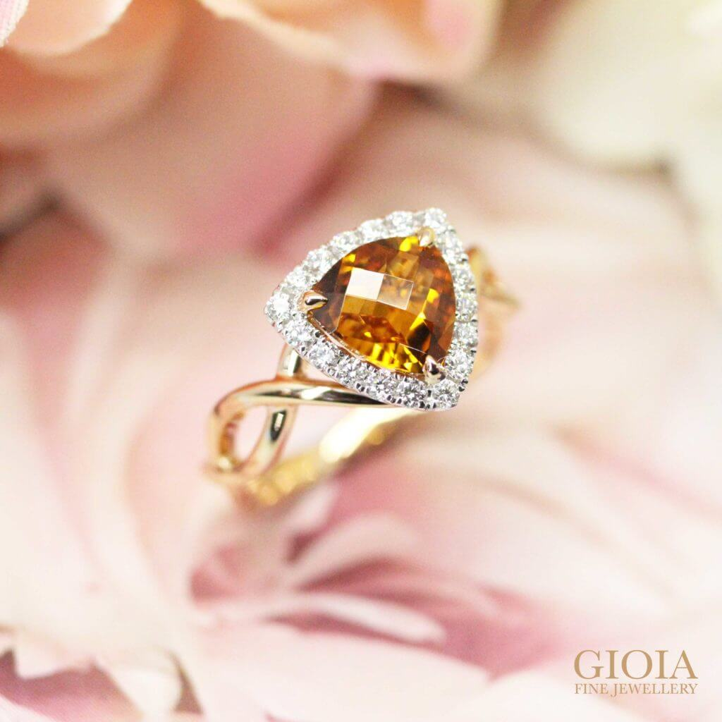 trilliant cut orange gemstone custom set in round brilliant diamonds and twisted bands | Local Singapore designer jewellery at GIOIA FINE JEWELLERY