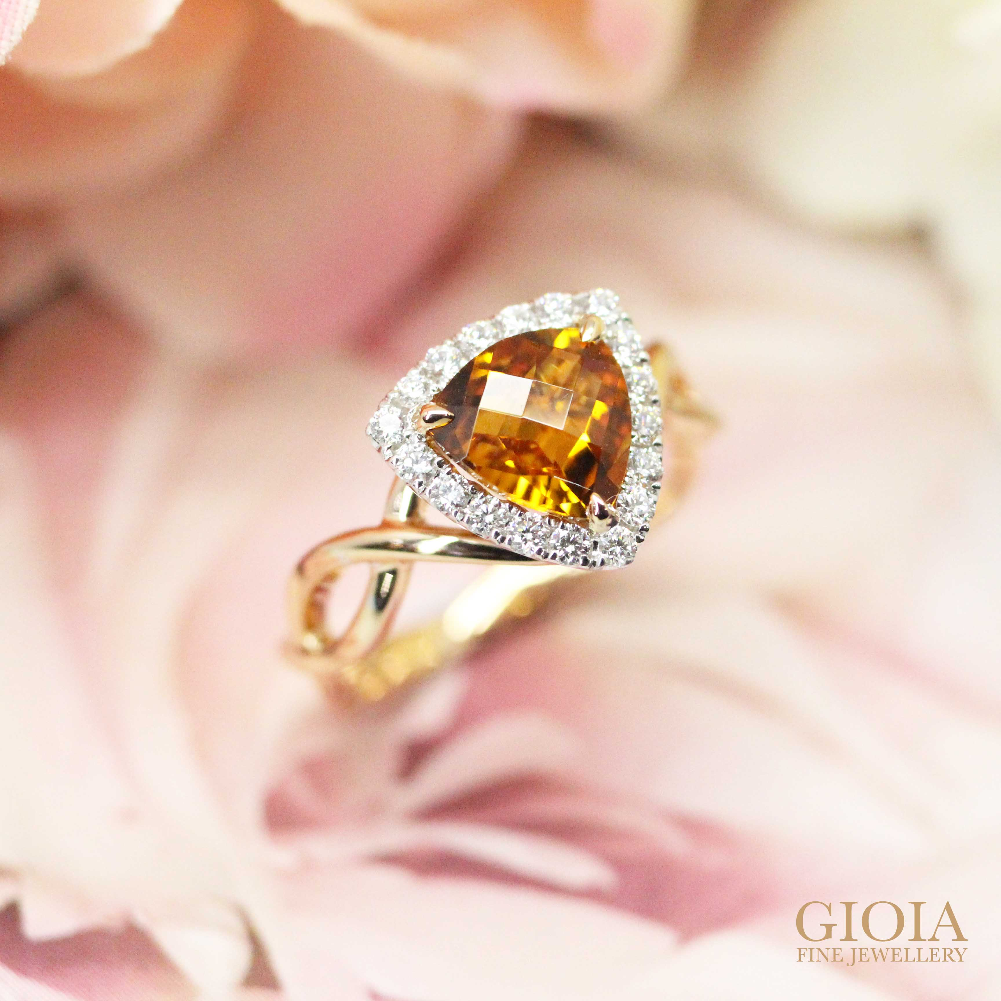 trilliant cut orange gemstone custom set in round brilliant diamonds and twisted bands | Local Singapore designer jewellery at GIOIA FINE JEWELLERY