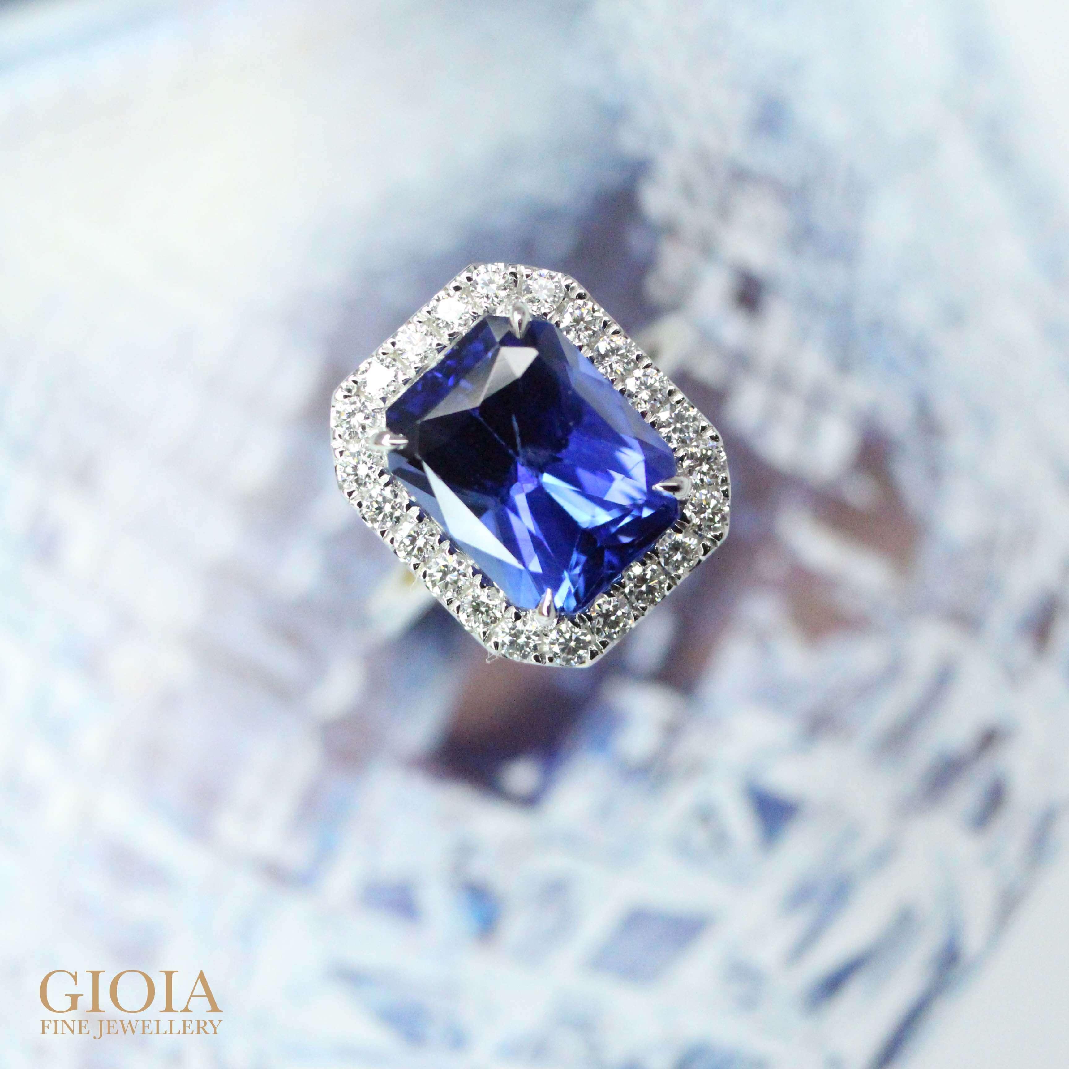 Customised blue sapphire engagement with halo round diamond surrounding the coloured gemstone | Local Singapore Bespoke jewellery
