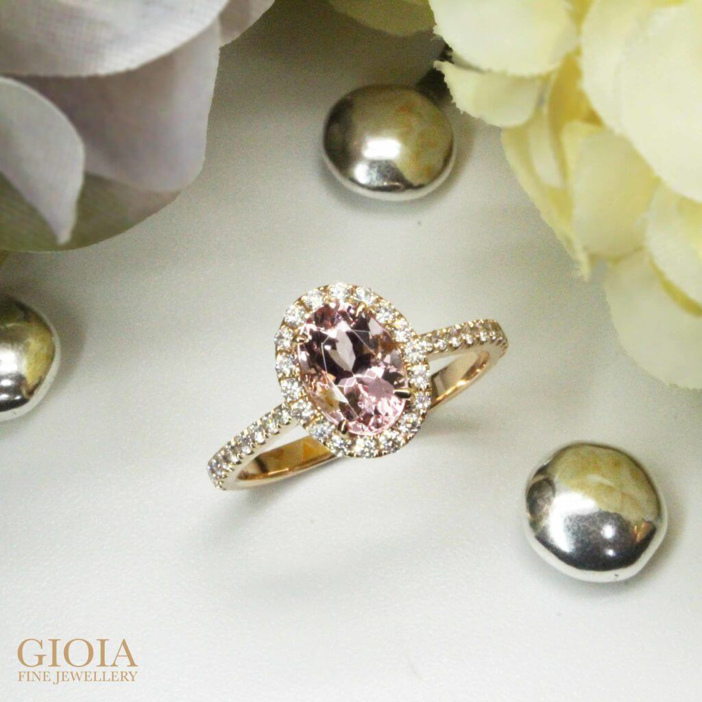 Morganite Pink Coloured Gemstone Customised with round brilliant Halo Diamond set around the Morganite and proposal ring bands. Custom made design Proposal Ring | Local Singapore Bespoke Jeweller in customised wedding proposal ring