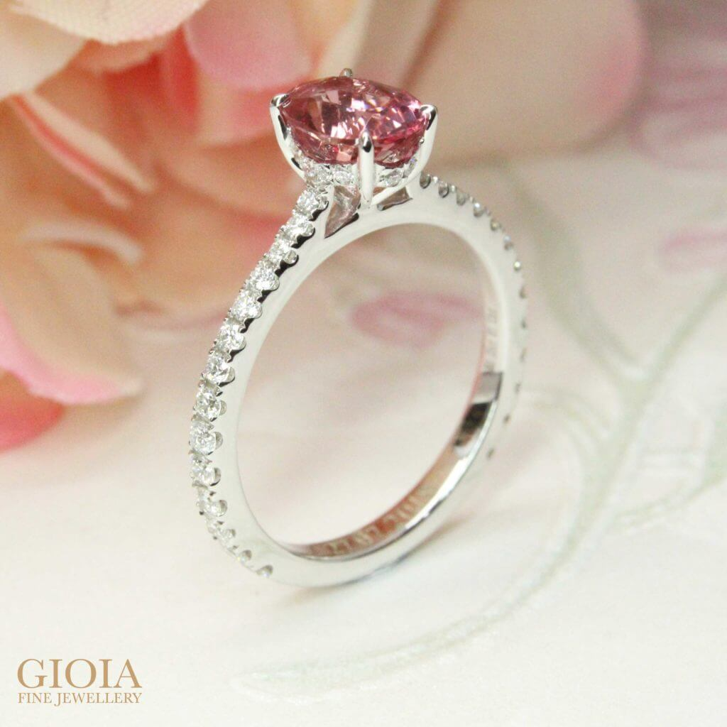 Customised Engagement Wedding Ring with rare padparadscha sapphire gemstone for a unique proposal. Custom made with different range of design, your unique wedding proposal begin here at GIOIA Fine Jewellery - Local Singapore Customised Engagement Ring with Coloured Gemstones