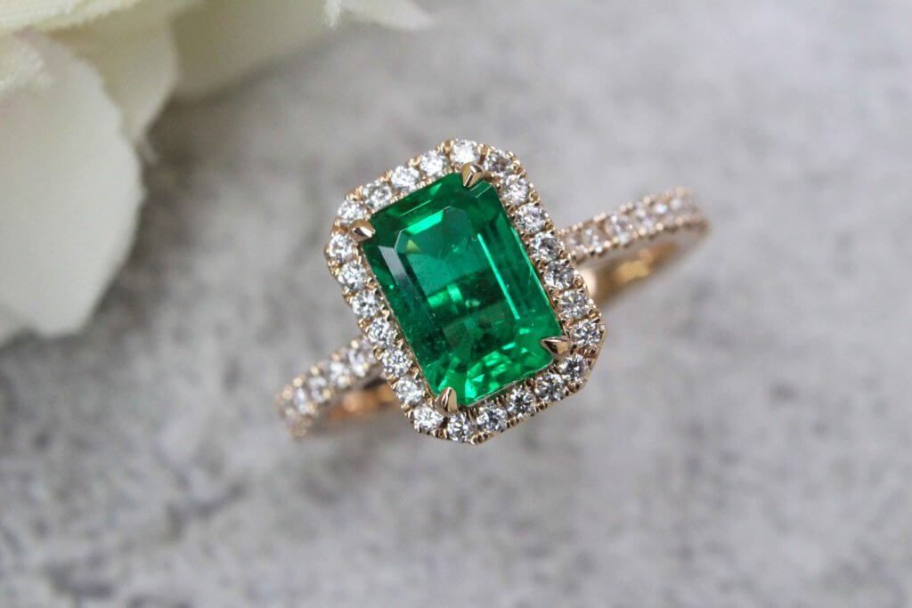 Emerald Engagement Ring with Halo Diamond, Customised Vivid green emerald gemstone for a unique proposal | Local Singapore private Jeweller in Custom made engagement Ring