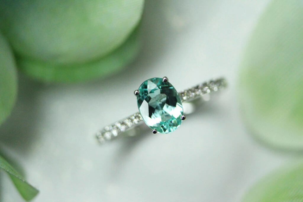 Paraiba Tourmaline Engagement Ring customised for wedding proposal, bluish green and greenish blue neon coloured paraiba tourmaline gemstone from Brazil and Mozambique | Local Singapore Private Jewellery in custom made wedding jewellery and engagement ring