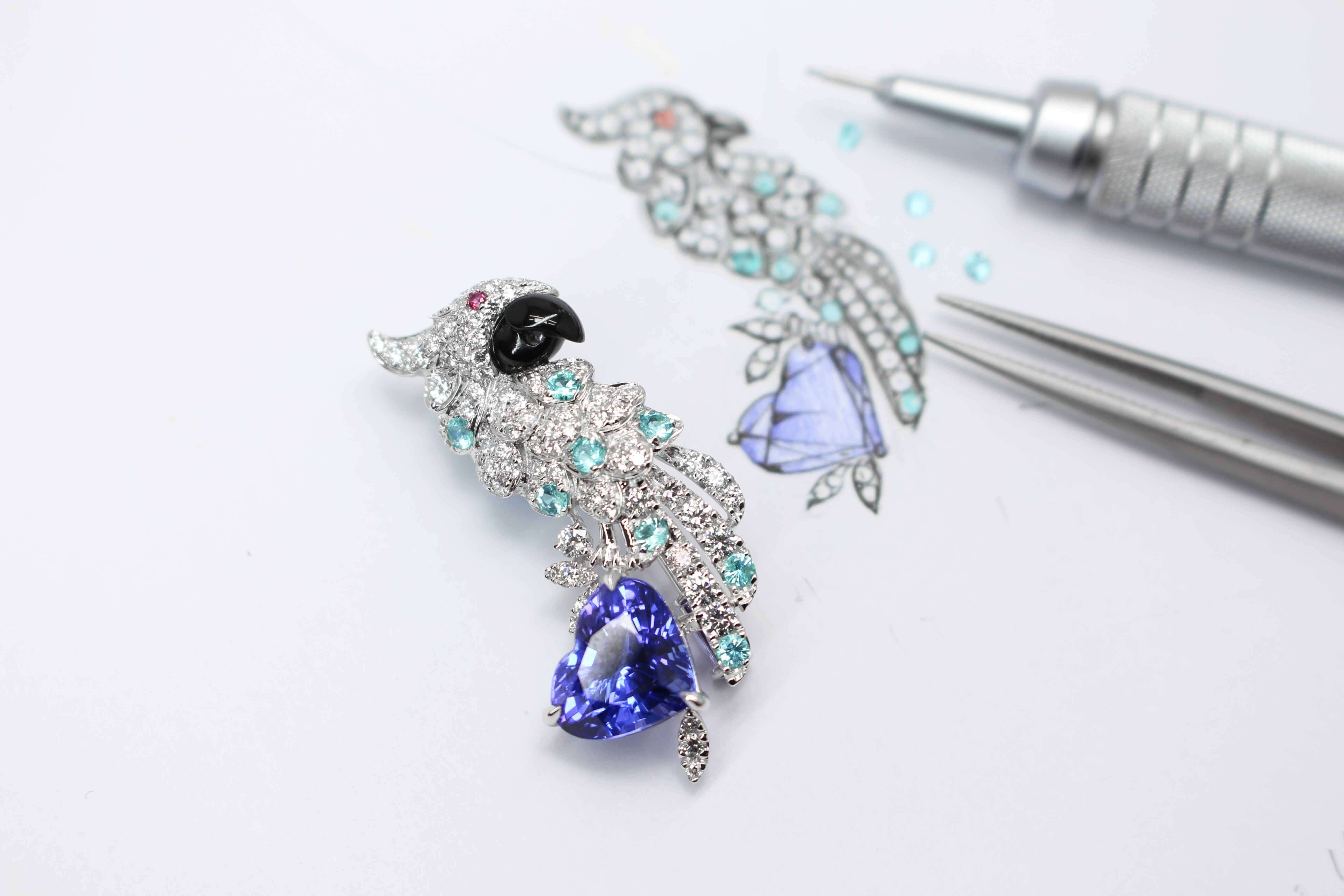 Customised Fine Jewellery in Parrot pendant and earring jewellery set. Custom set with diamonds, brazil paraiba tourmaline and tanzanite coloured gemstones | Local Singapore Private Jewellery in customised fine jewelley