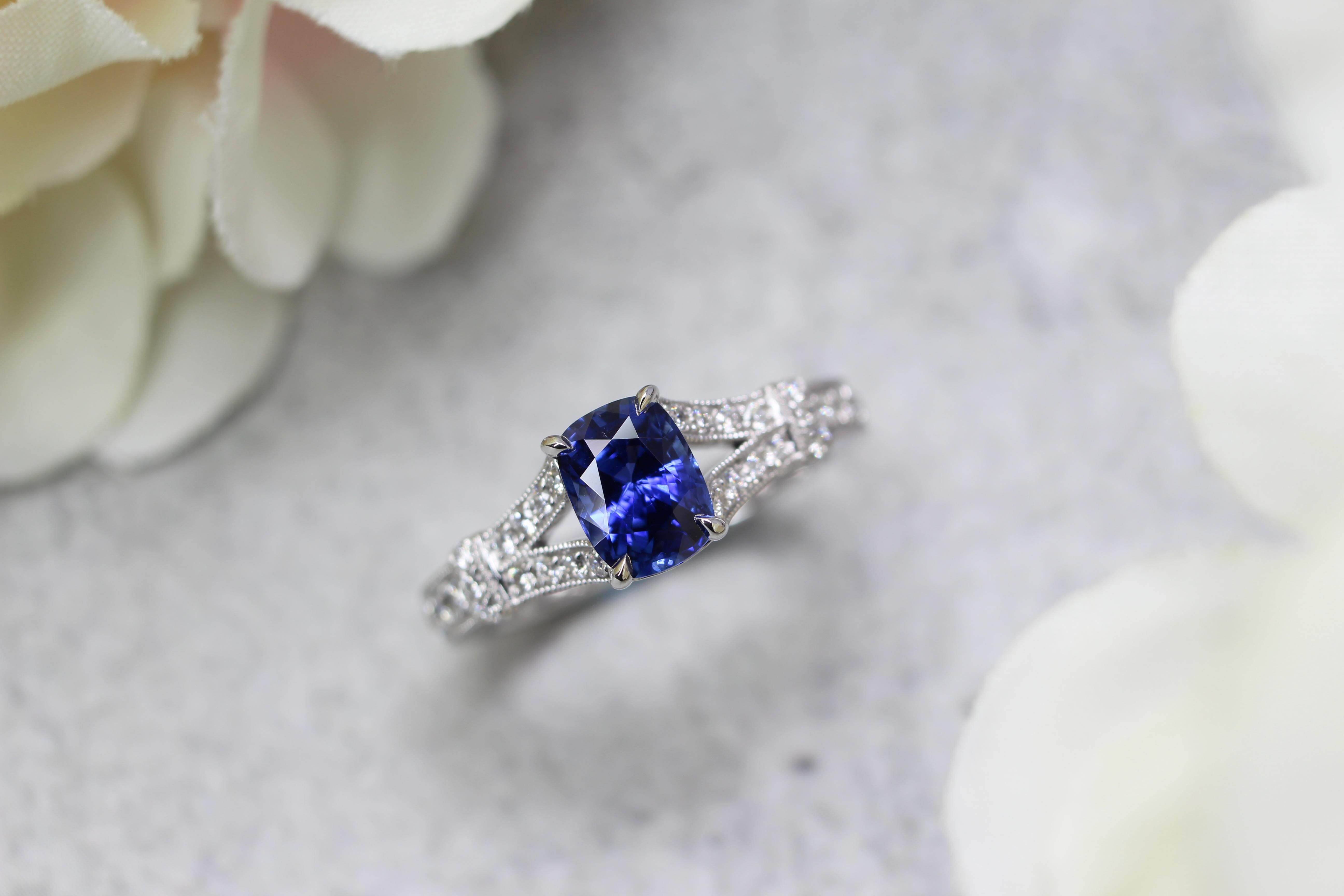 Eiffel Tower Blue Sapphire Engagement Ring - customised to eiffel tower on the band of the engagement ring with blue sapphire | Local Singapore Private Jeweller in customised wedding jewellery