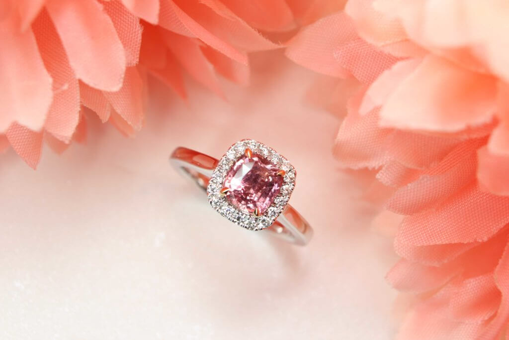 Customised Padparadscha Sapphire Gemstone with halo diamond ring - Customised Engagement Ring for proposal with rare orange pink sapphire gemstone. Cushion padparadscha sapphire gemstone jewellery | Local Singapore Customised Jeweller in Wedding Jewellery