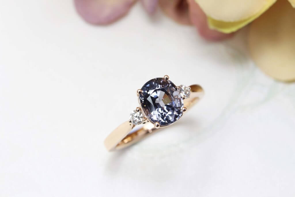 Customised Purplish Grey Spinel, coloured gemstone engagement ring - Custom made design for the couple for a unique proposal with purplish grey spinel coloured gemstone | Local Singapore bespoke jeweller in wedding jewellery - Customised Jeweller