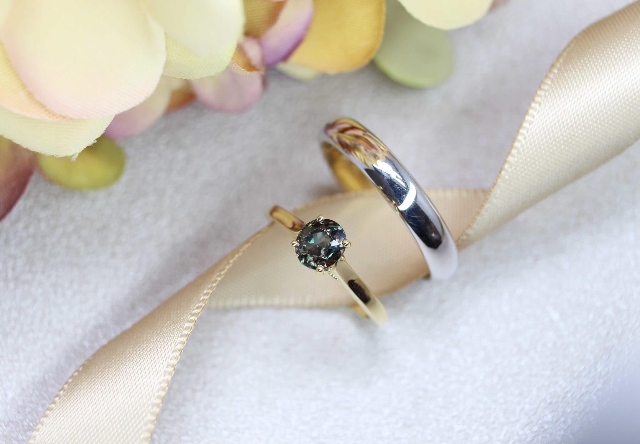 Alexandrite Colour Change with Green under different lighting. Customised Engagement ring and Wedding Band with unique and rare alexandrite gemstone   Local Singapore bespoke Jewellery in customised wedding jewellery