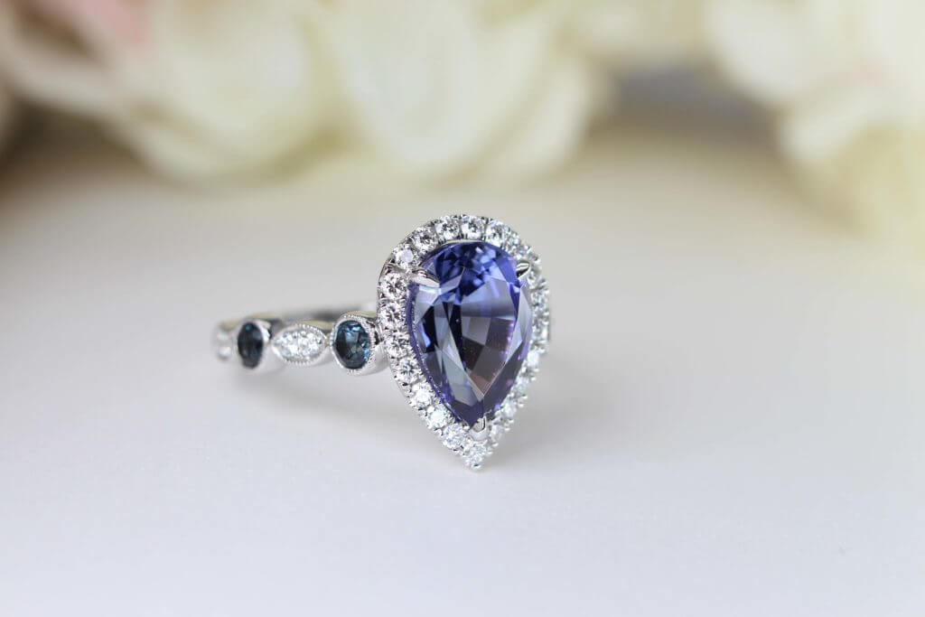 Customised Tanzanite Ring, Tanzanite with Violet, Blue with halo round diamond. Pear Shaped Tanzanite Gemstone Ring | Local Singapore Bespoke Fine Jewellery with Customised Jewellery GIOIA Fine Jewellery in Tanjong Pagar