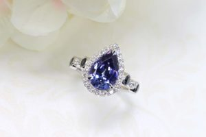 Customised Tanzanite Ring, Tanzanite with Violet, Blue with halo round diamond, and blueish spinel on side bands. Pear Shaped Tanzanite Gemstone Ring | Local Singapore Bespoke Fine Jewellery with Customised Jewellery GIOIA Fine Jewellery in Tanjong Pagar