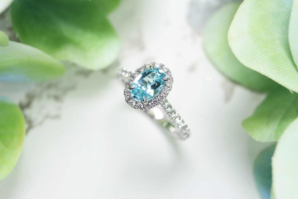 Personalised Engagement Ring with Paraiba Tourmaline Gemstone with unique design for a proposal with own personalised initials on the ring | Customised Jeweller in wedding ring and wedding jewellery with paraiba tourmaline gemstone in Singapore