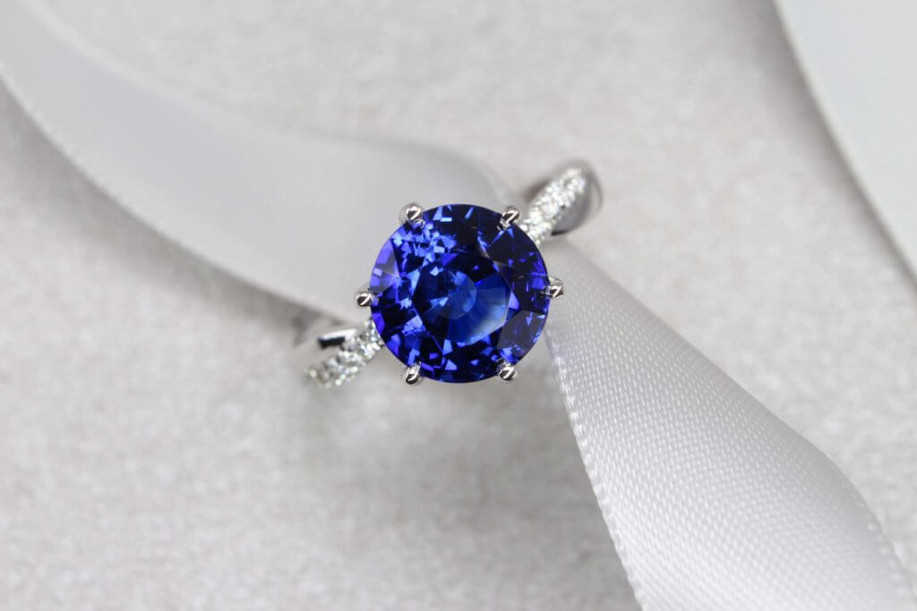 Unique rare round shape cut blue sapphire customised with round diamond engagement ring | Local Singapore Jeweller in wedding jewellery and wedding rings