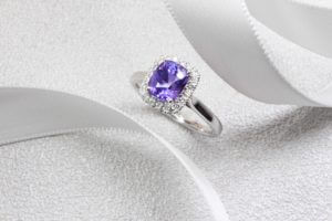 Violet Sapphire with halo round brilliant diamonds, coloured gemstone in violet and purplish shade. Unique customised sapphire ring from husband to wife   Local Singapore Jeweller in Customised Jewellery, design from sketch design jeweller - Private Jeweller