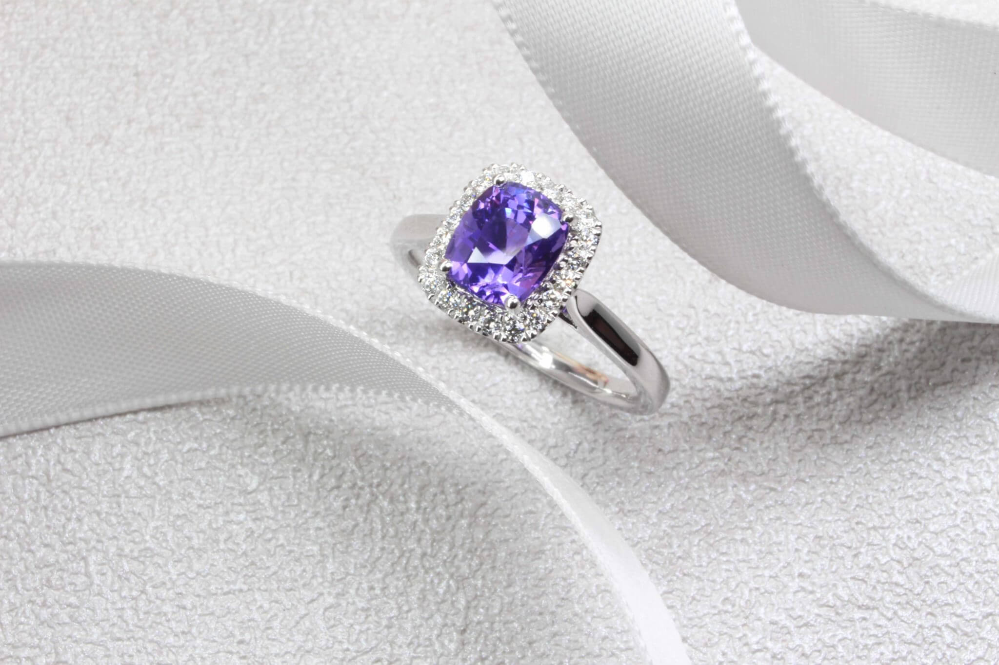 Violet Sapphire with halo round brilliant diamonds, coloured gemstone in violet and purplish shade. Unique customised sapphire ring from husband to wife | Local Singapore Jeweller in Customised Jewellery, design from sketch design jeweller - Private Jeweller