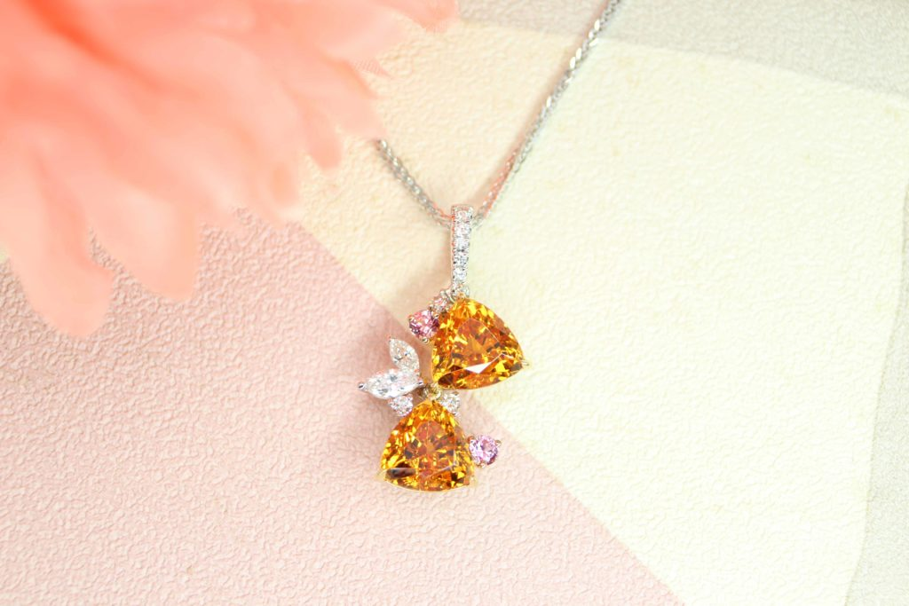 Mandarin Garnet in a pair customised to Pendant with unique Trilliant shape, customised in a non traditional bespoke setting - bespoke Jewellery | Local Bespoke Jewellery in fine jewellery with coloured gemstone.