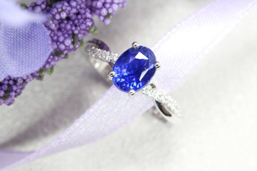 Vivid cornflower blue with wedding bands in platinum gold ring, highly saturated blue which gives out a neon glowing shade cornflower vivid blue sapphire coloured gemstone | Local Singapore Custom jeweller in wedding rings and jewellery with sapphire gemstone.