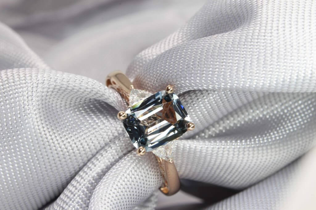 Bluish Grey Spinel Coloured Gemstone Customised for Engagement Ring - Customised Wedding Ring with spinel coloured gemstone and diamond on side band   Local Singapore Jeweller in blue sapphire with diamond and design