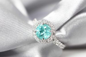 Customised electric blue or mint green Paraiba Tourmaline Proposal Ring - custom made to different classic yet stylish pieces of wedding jewellery | Local Singapore Jeweller in customised jewellery with paraiba tourmaline coloured gemstone