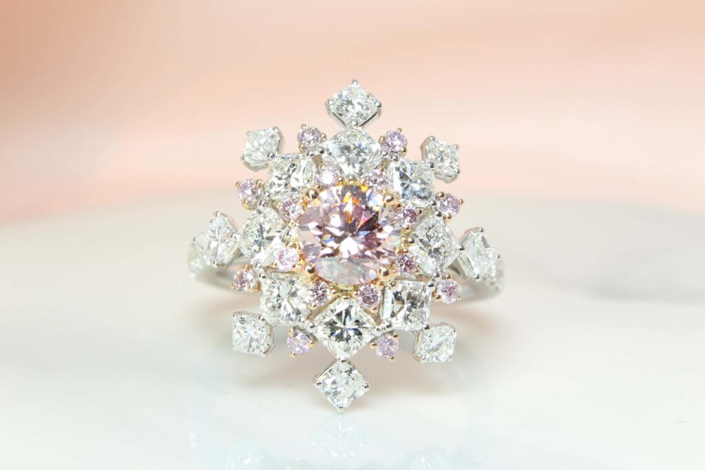 Pink Diamond, truly exquisite in design, quality and colour. Featuring a pink-hued diamond surrounded with sparkling diamonds is a fantastic expression of feminine chick. Local Singapore Jeweller in Customised Fine Jewelry with diamond and coloured gemstone.