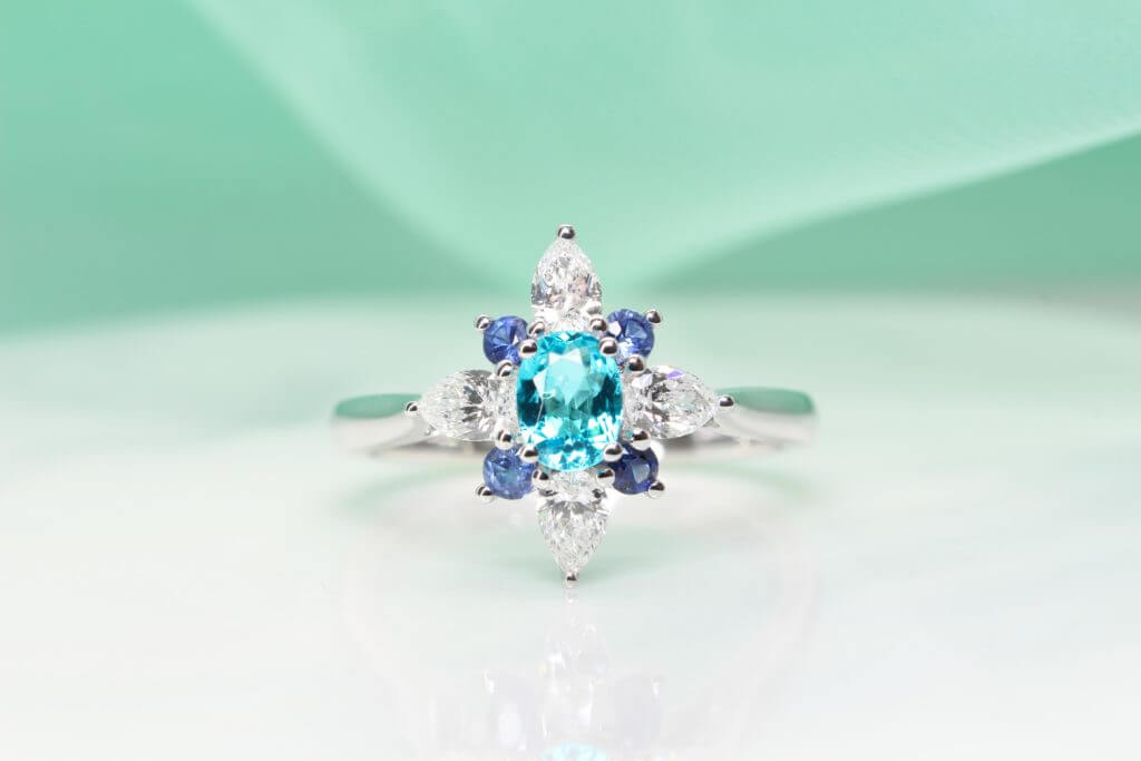 Brazil Paraiba Tourmaline Ring customised and design with pear shaped diamond and round brilliance blue sapphire inspired by a flora design - Customised Engagement Ring with local Singapore bespoke customised jeweller, with Mozambique and Brazil Paraiba