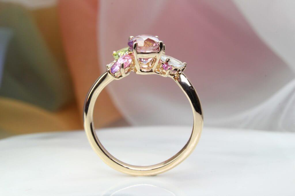 Custom made Cluster Ring with Coloured Gemstone - Crafted in rose gold, this cluster ring features multiple coloured gemstones. A stunning look is created with this ring consisting of Diamond, Peridot, Aquamarine and Sapphire | Local Jeweller in Custom made fine Jewellery and wedding jewellery.
