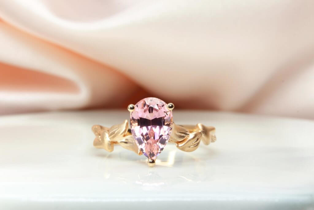 Pear shaped pink tourmaline customised into a floral wedding ring for a unique engagement ring for proposal. One of the most unique designs ever crafted by us in GIOIA Fine Jewellery | Local Singapore Jeweller in bespoke customised wedding ring and engagement ring with coloured gemstones.