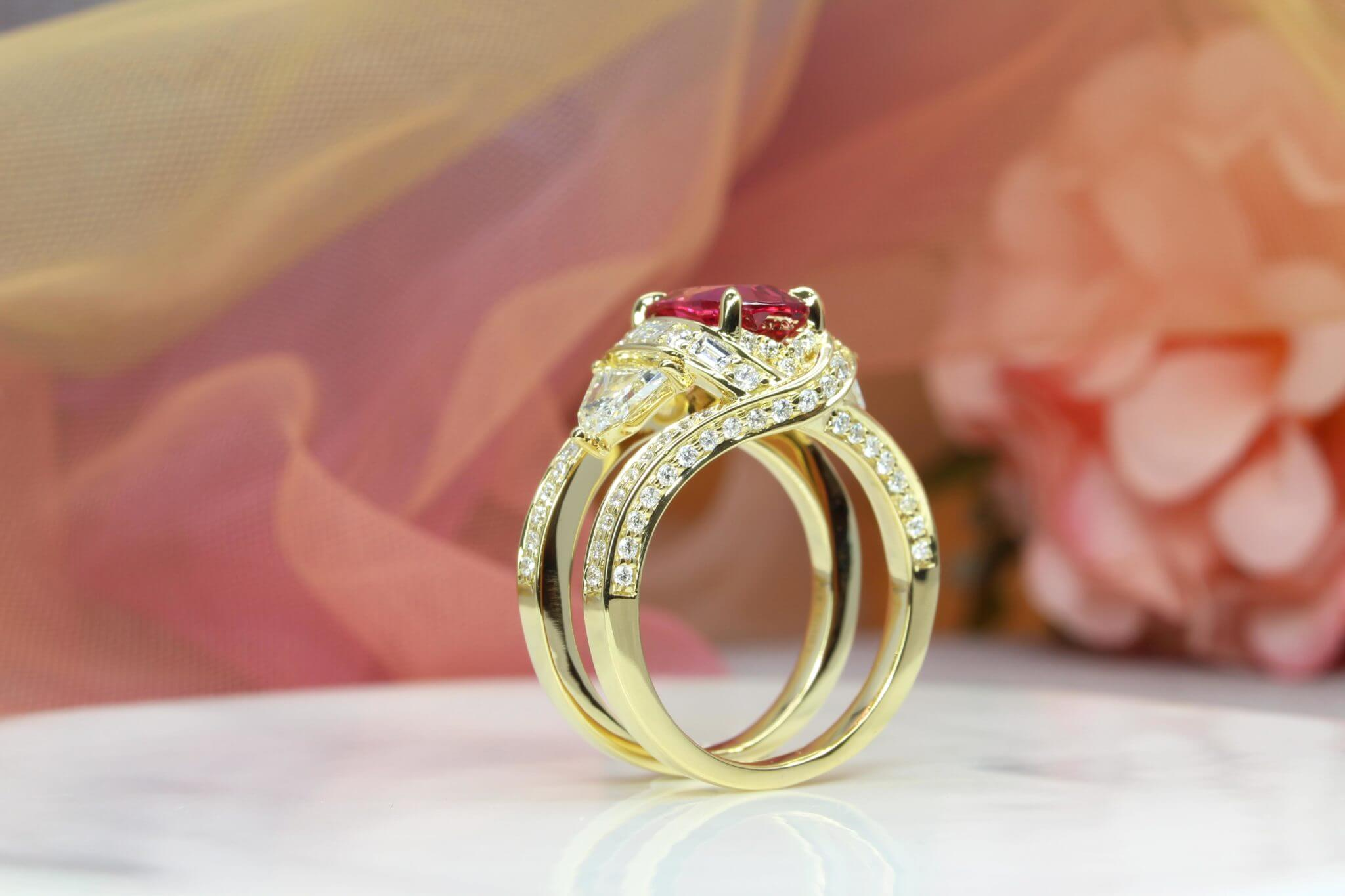 Mahenge Red Pink Spinel Gemstone customised with chevron, baguette and brilliant round diamonds. Mahenge spinel is found in Tanzania, one of the most sought after colour of spinel in the world | Local Singapore Bespoke Ring and Jewellery Designer