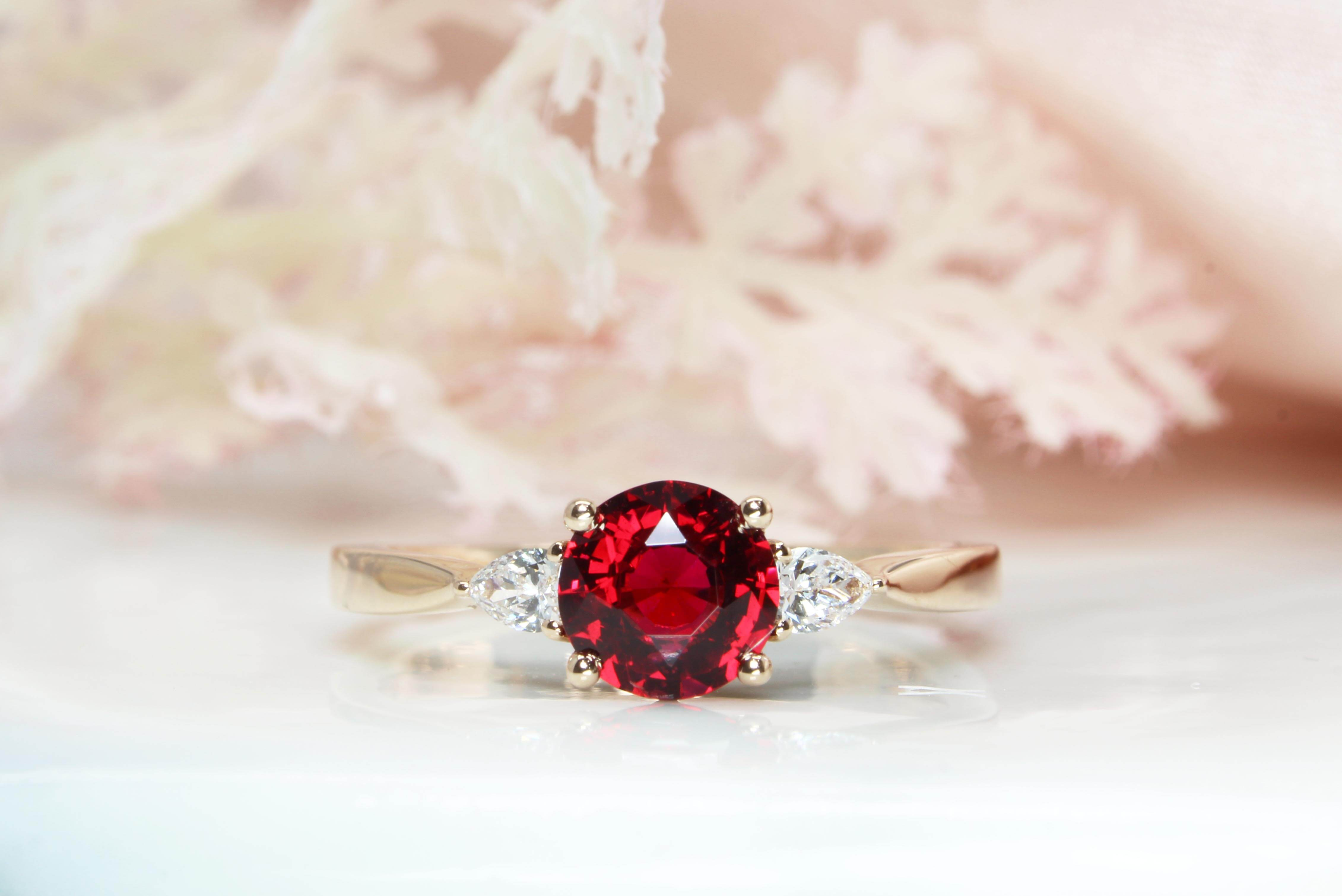 Red Spinel custom design with two pear shape diamonds, crafted in rose gold, the detailing on the side bands of the engagement ring for a proposal | Local Singapore custom made jeweller in engagement ring and wedding jewellery with spinel gemstone.