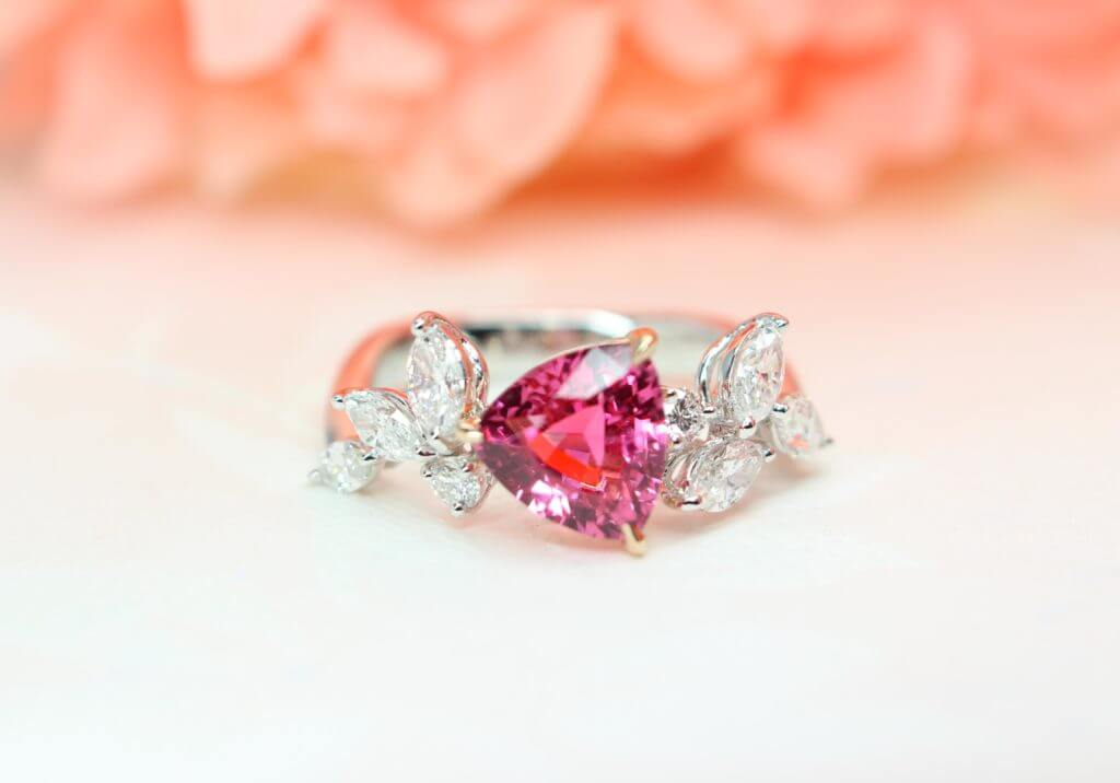 Bright Pink Mahenge Spinel Gemstone in trilliant cut shape and marquise shaped diamond which give a distinctive design look - Customised Jewellery in Singapore, custom made to the wear with unique jewellery design.