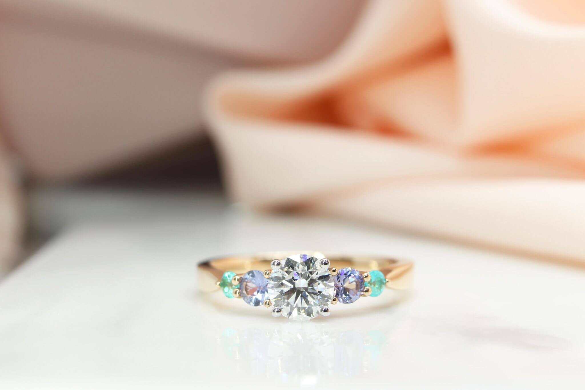 Diamond with Gemstone Engagement Ring customised with Paraiba Tourmaline and blue Sapphire custom made in rose gold and white gold band | Local Singapore Jeweller in Customised Engagement Ring with Diamond and coloured gemstone paraiba and sapphire