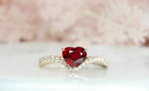 Heartshape Ruby Pigeonblood skilfully cut in well symmetry and polish to give an exceptional brilliance in the ruby. Crafted from sketch to a unique wedding engagement ruby ring | Customised Engagement by local Singapore customised jewellery in wedding jewellery.