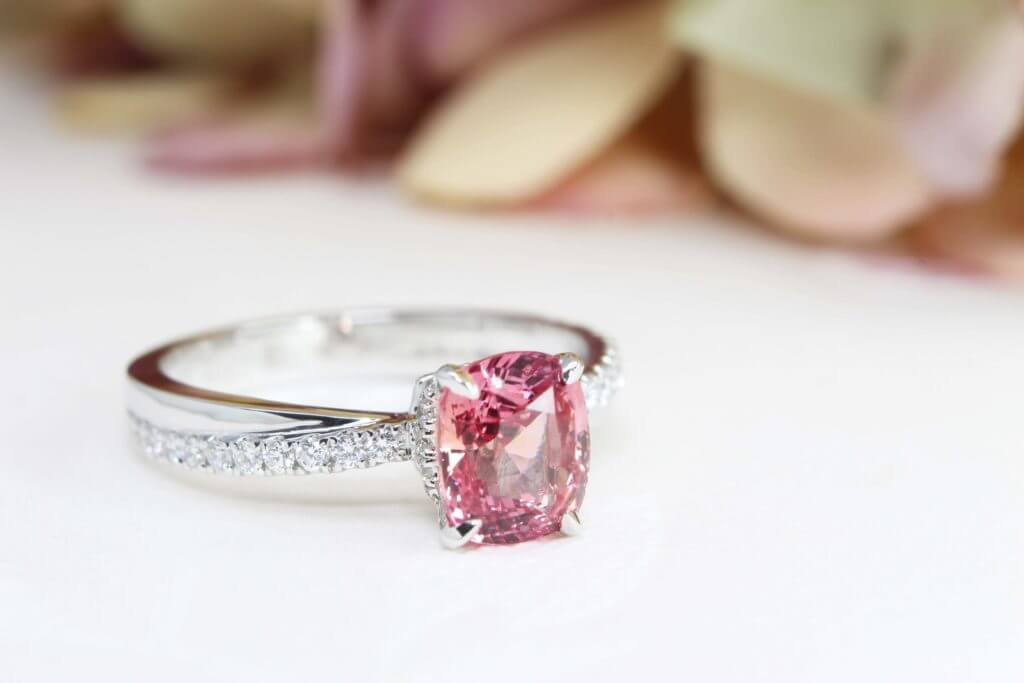Padparadscha Sapphire customised with halo and twisted round brilliance diamond Engagement Ring - Customised Jewellery with orange and pink colour shade sapphire | Local Singapore customised jeweller in sapphire for wedding jewellery