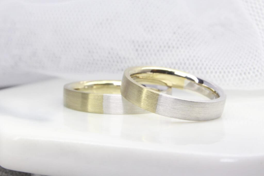 Platinum with Natural White Gold, this customised wedding band has been custom-made with platinum gold PT950 and Natural white gold Au 750   Singapore Local Jewellery in customised wedding jewellery and wedding bands. Sleek and elegant, this wedding band creates a contemporary and delicate look all at once.