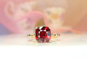 This cinderella carriage fairy tale design ring is a classic example of timeless artistry with vivid red spinel gemstone. The delicate designing of the pumpkin coach featuring a majestic red spinel and diamond elegantly completes this modern design | Local Singapore Jeweller in customised jewellery and wedding jewellery with fairy tale story.