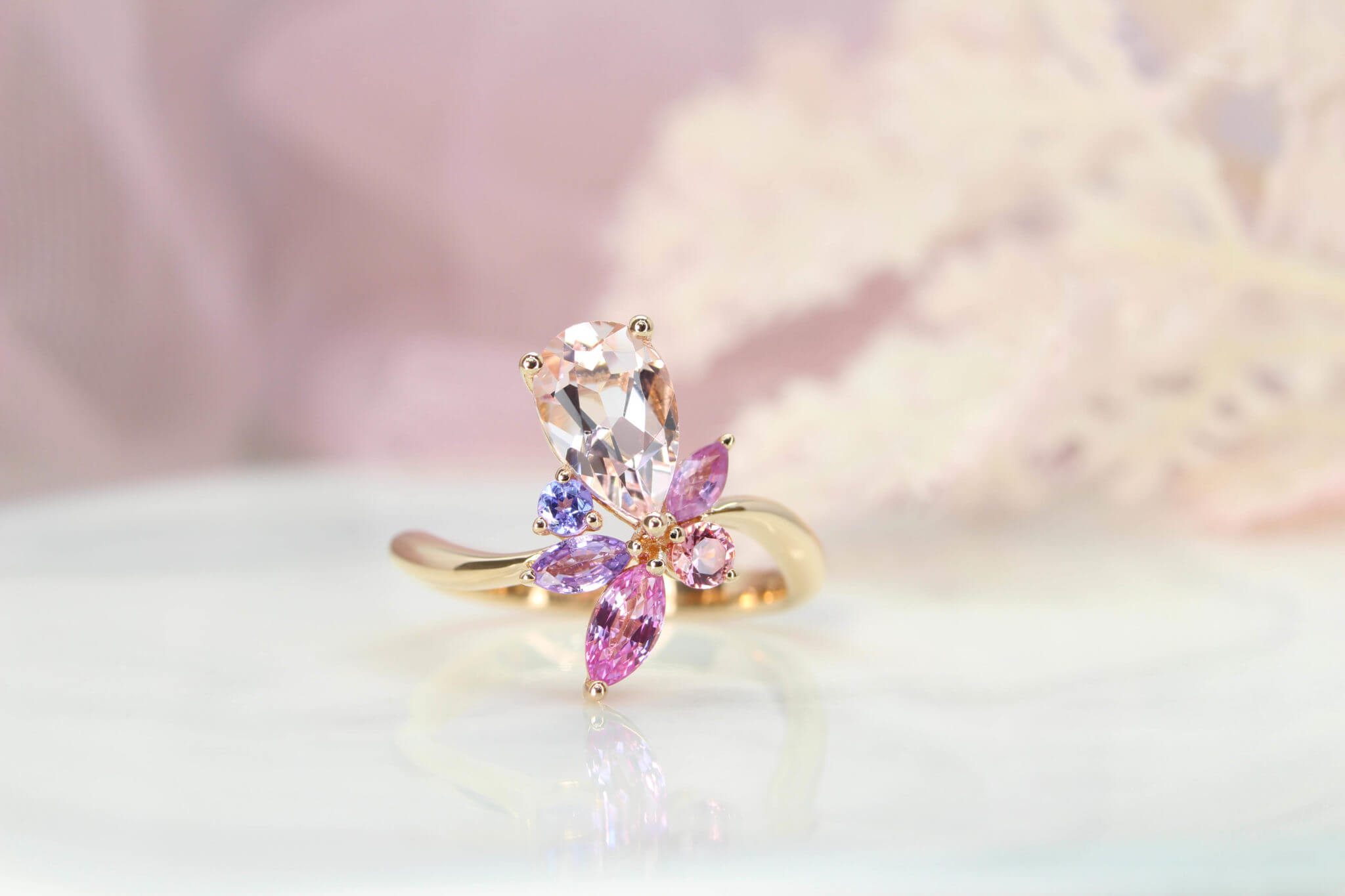 Floral Engagement Ring, customised with Morganite pear with orange and pink coloured shade, violet and pink sapphire in marquise shapes. Designed and crafted to a unique floral engagement ring | Local Singapore Jeweller customised engagement ring in floral design.