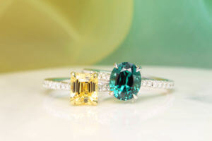 Family Heirloom Ring, customised to be stackable for daily wear and intend to pass the pair to her daughters in future. Unheated yellow sapphire gemstone and vibrant lagoon tourmaline gemstone customised with round brilliance diamond | Local Singapore Jeweller in customised jewellery with rare precious gemstone.