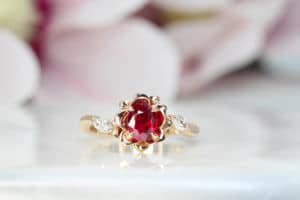 Engagement ring features an unheat vivid red ruby rare gemstone. With a liking for flora design, we customised this engagement ring with marquise diamond with flora leaves and petals in rose gold surrounding the ruby gemstone | Local Singapore Jeweller in engagement ring and wedding jewellery.
