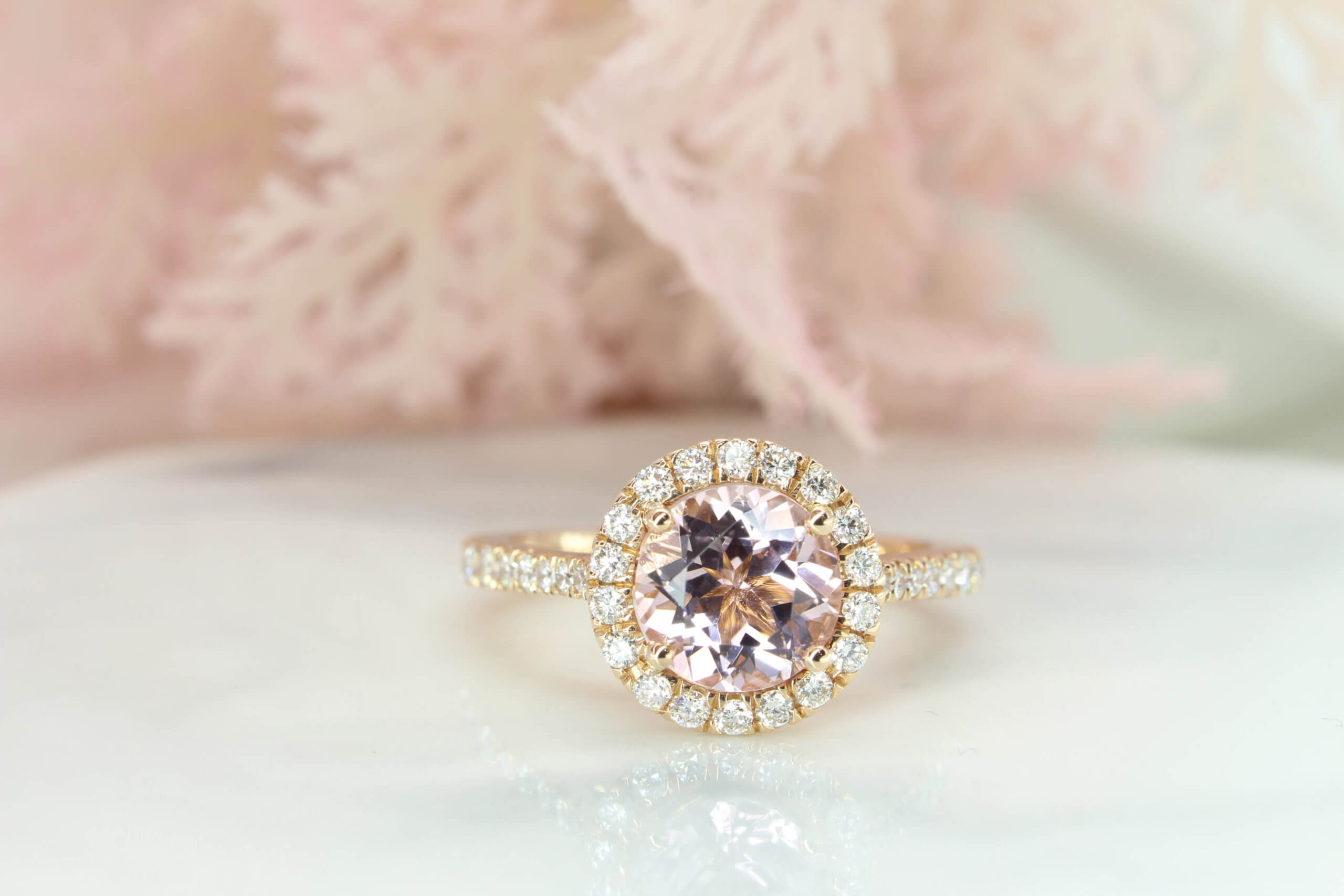 Morganite Diamond Halo Ring Customised for Wedding Proposal, fine morganite gemstone cut in round shape and designed with a halo of round diamond surrounding the morganite. Unique sweet baby pink morganite gemstone crafted in rose gold for a perfect wedding proposal | Local Singapore Jeweller in customised Engagement ring for Wedding Proposal