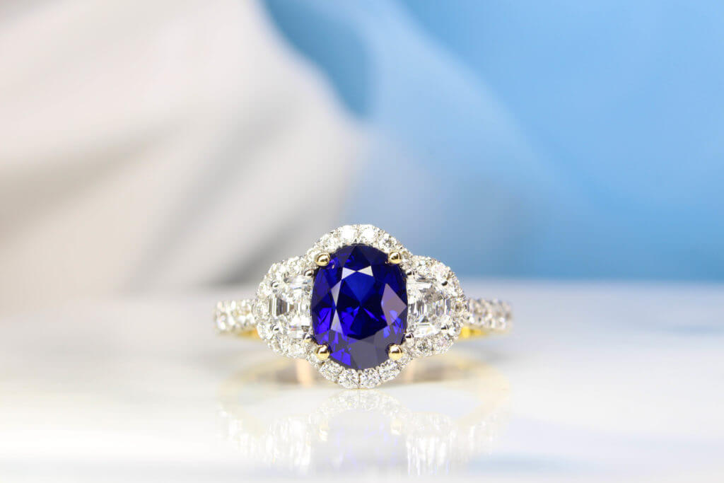 Royal Blue Sapphire with halfmoon and halo diamond ring