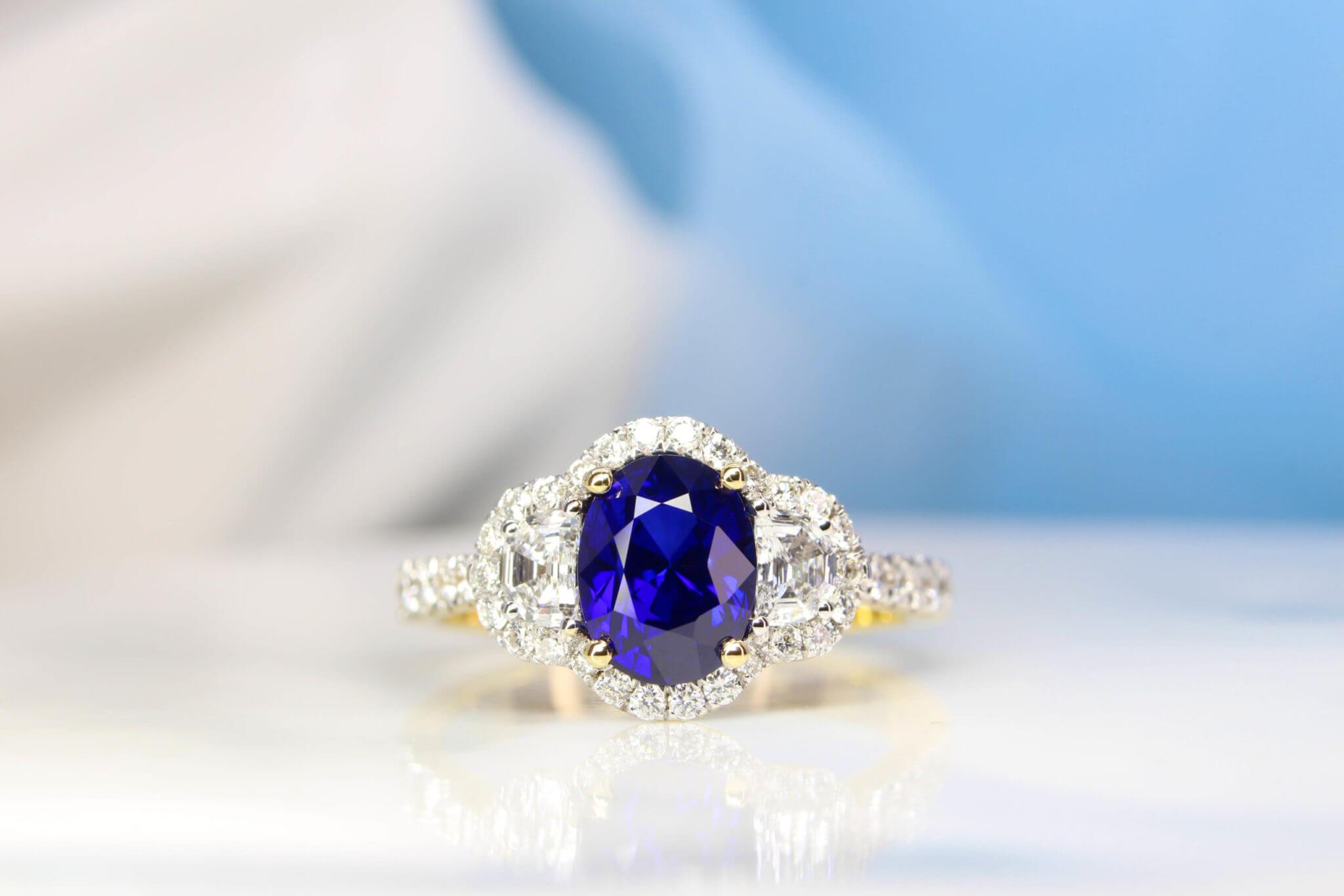 Royal Blue Sapphire with halfmoon and halo diamond ring