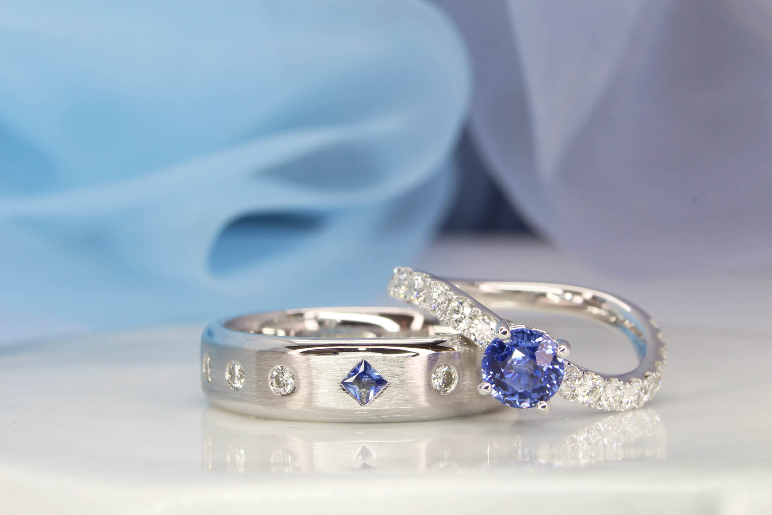 Anniversary Ring customised with Blue sapphire and round brilliance diamond. Customised for a couple keen on wanting a unique design for their wedding anniversary rings | Local Singapore Customised Wedding Anniversary Ring with Sapphire and Diamond