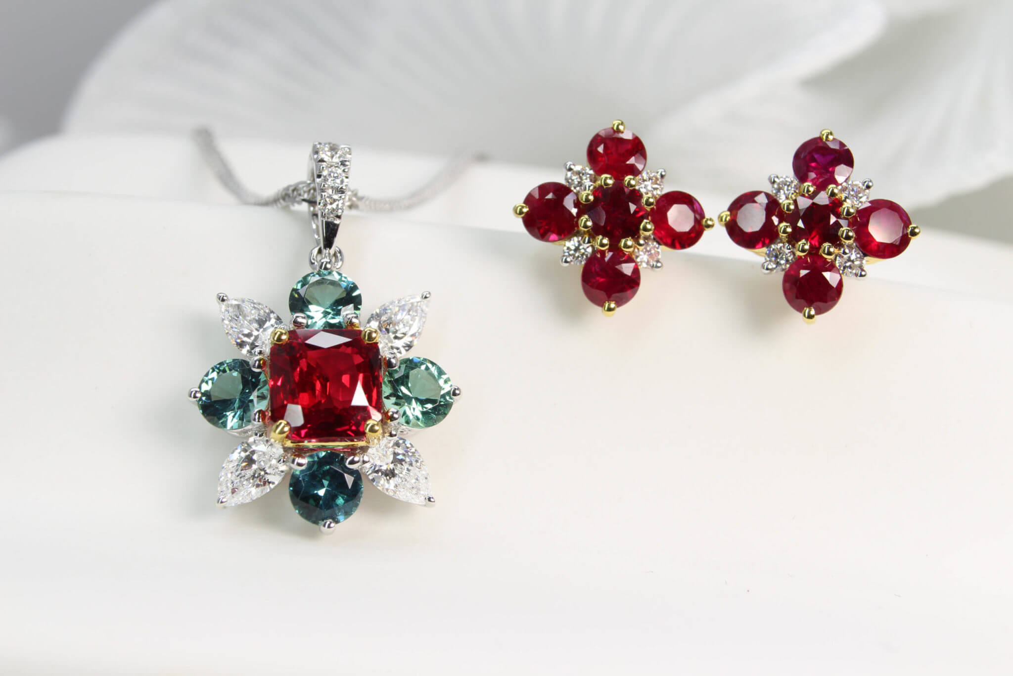40th Anniversary Wedding Jewellery, Featuring unheated ruby depend clustered with round green tourmaline and pear diamond around the ruby gem. The cluster earring with ruby and diamond gems design and customised for a 40th anniversary wedding jewellery | Local Singapore Jeweller in ruby and coloured gemstone