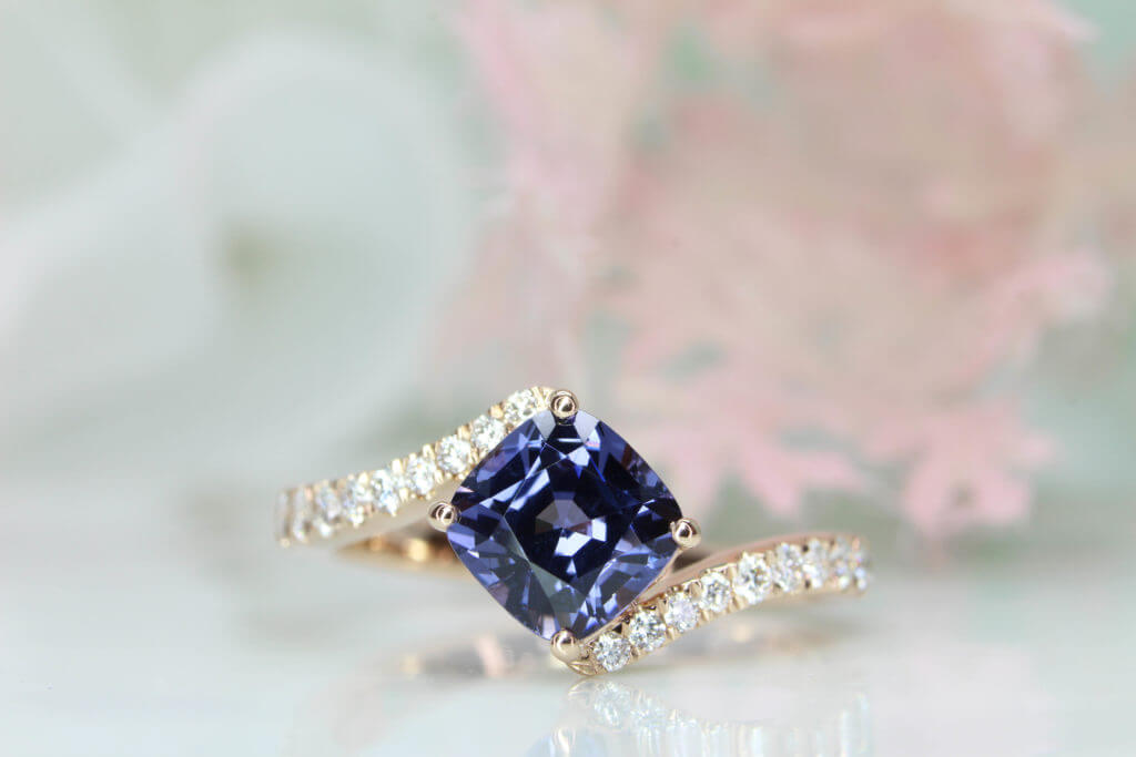 Violet Blue Spinel Proposal Ring customised with diamond in rose gold band - Unique Wedding Proposal with violet blue spinel gemstone. Tweak in the orientation of the cushion gem, rich colour make the design truly extraordinary proposal ring | Local Singapore Jewellery in Customised Proposal Ring