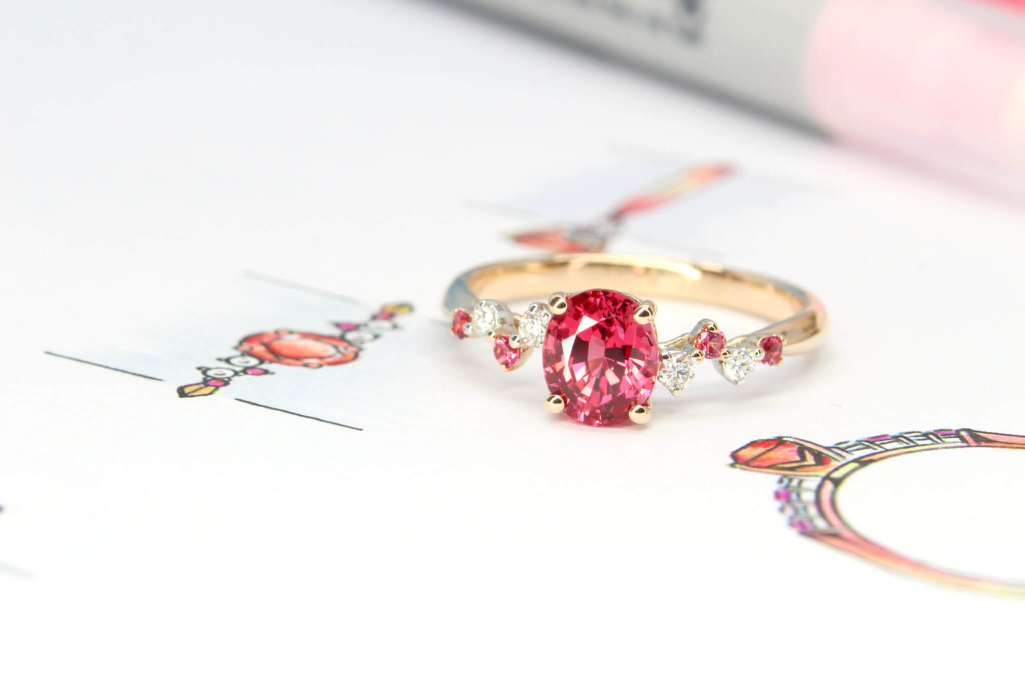 Customised Jewellery Pinkish Red Spinel Gem designed with round brilliant diamond and similar pinkish red spinel setting customised to the proposal ring - Customised Proposal Ring with vivid pinkish red spinel gemstone and diamonds adds dazzle to the overall design | Local Singapore Jeweller in customised proposal ring and wedding rings.