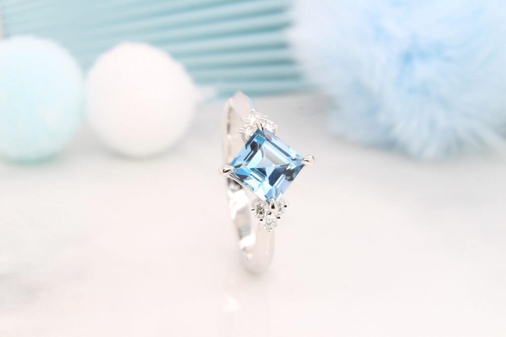 Santa Maria Africa coloured Aquamarine Engagement Ring, unique princess step cut aquamarine gem is customised with round brilliant cluster diamond - Singapore