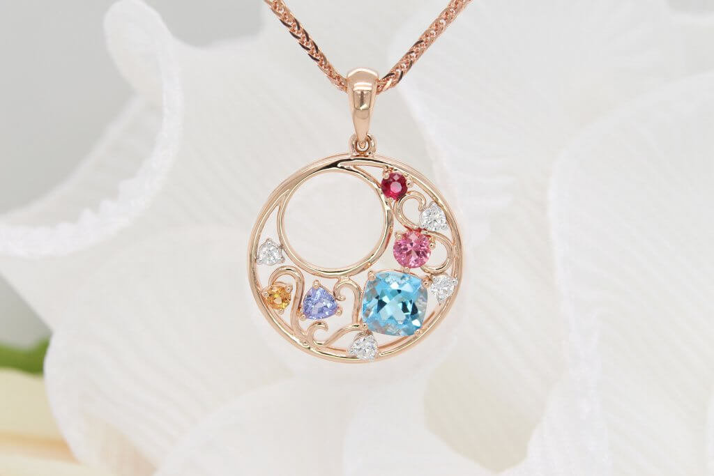 Personalised pendant make a memorable gift with birthstone jewellery from ruby, mandarin garent, topaz, tanzanite and spinel